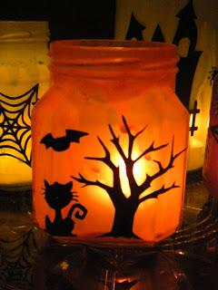 spooky jar craft showing a spooky halloween scene featuring a bat, cat and tree