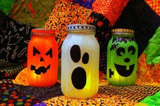 spooky jars craft showing a pumpkin, a ghost and frankenstein jars